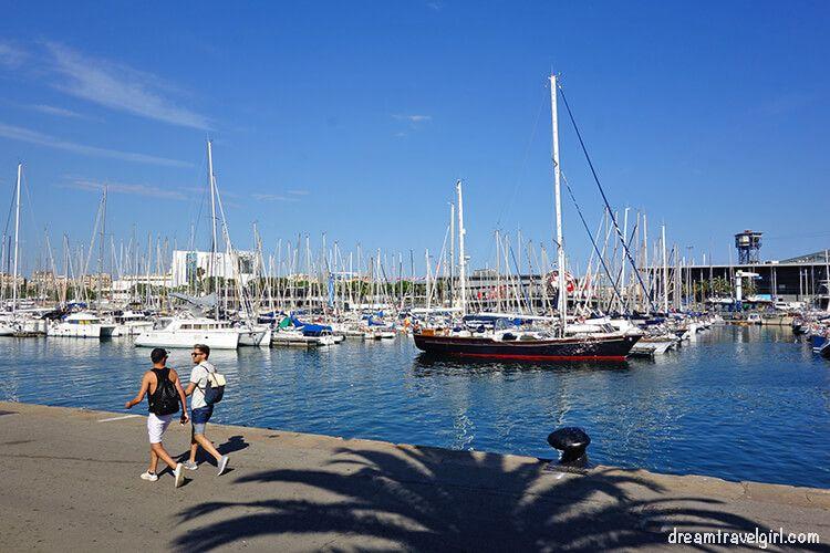 People walking along the harbor