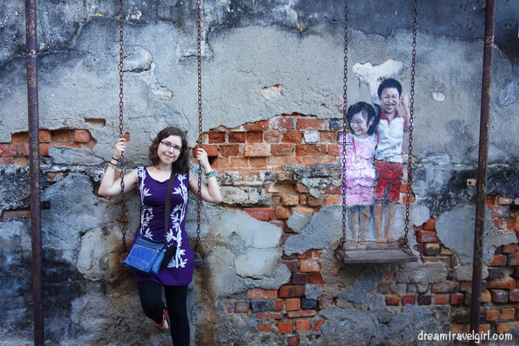 "Street art in Georgetown ""brother and sister on a swing"""