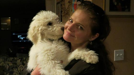 """Me holding our standard poodle puppy """"Pele""""!"""