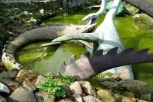 3 Saurier kämpfen im Wasser