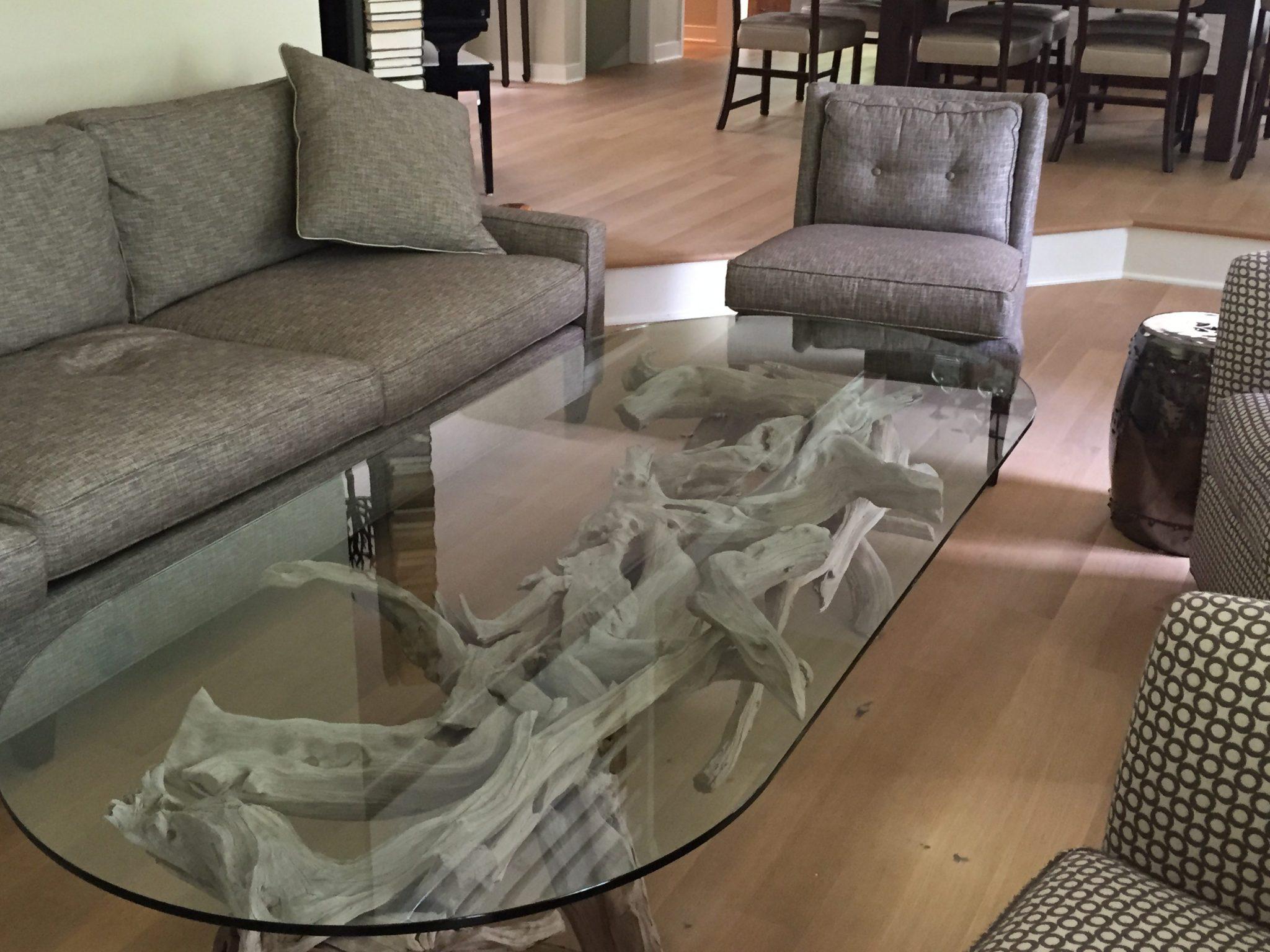 A very long faded sandblasted coffee table