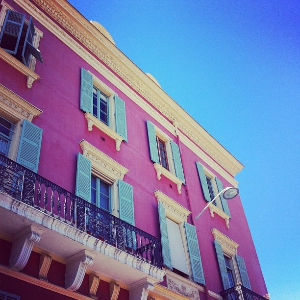 Pastel pink and blue buildings in Nice, South France, Riviera