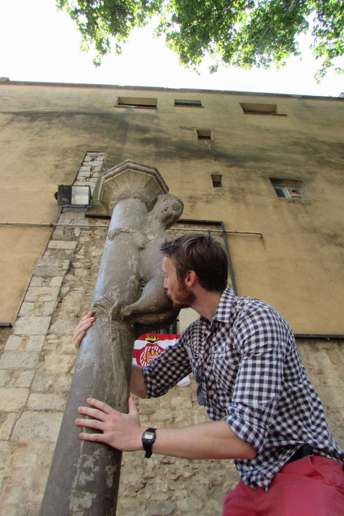 Kissing the lion's ass at St. Fèlix Church, because doing so ensures that you will one day return to Girona