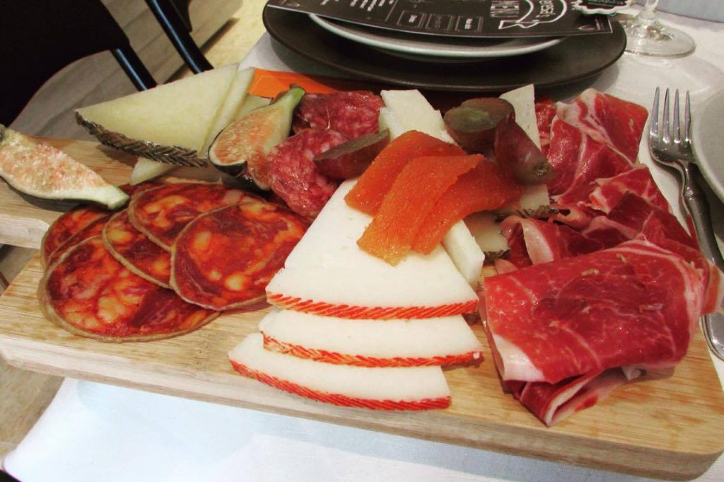 "Traditional Spanish Tapas: jamón, sliced sausages and cheese with ""membrillo"""
