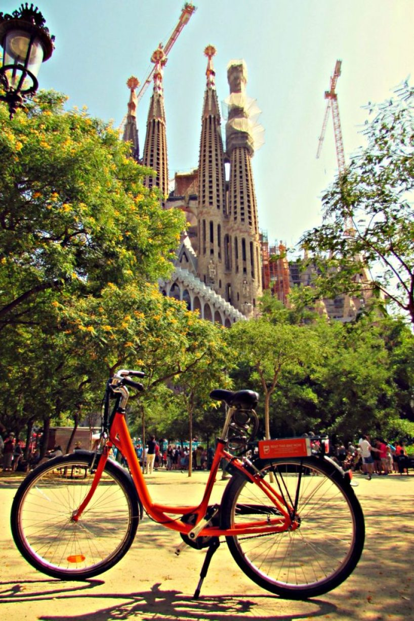 Orange Donkey Republic rental bike at La Sagrada Familia in Barcelona