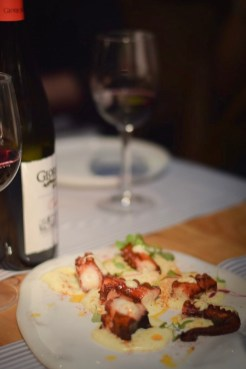 Crispy 'pulpo' octopus served on a bed of creamy mashed potato - Barcelona Food Experiences