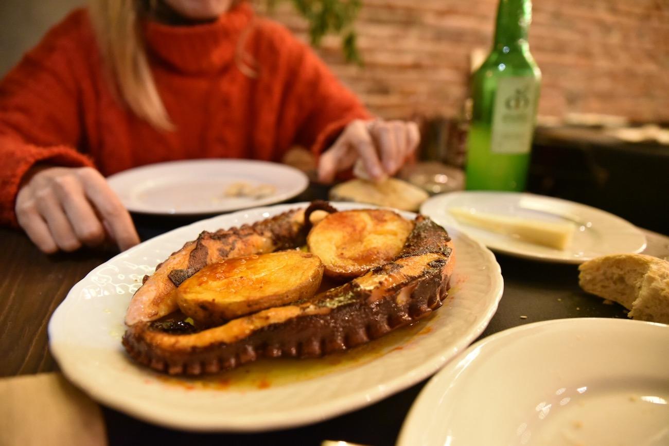 Eating pulpo (octopus) in Llanes, Asturias.