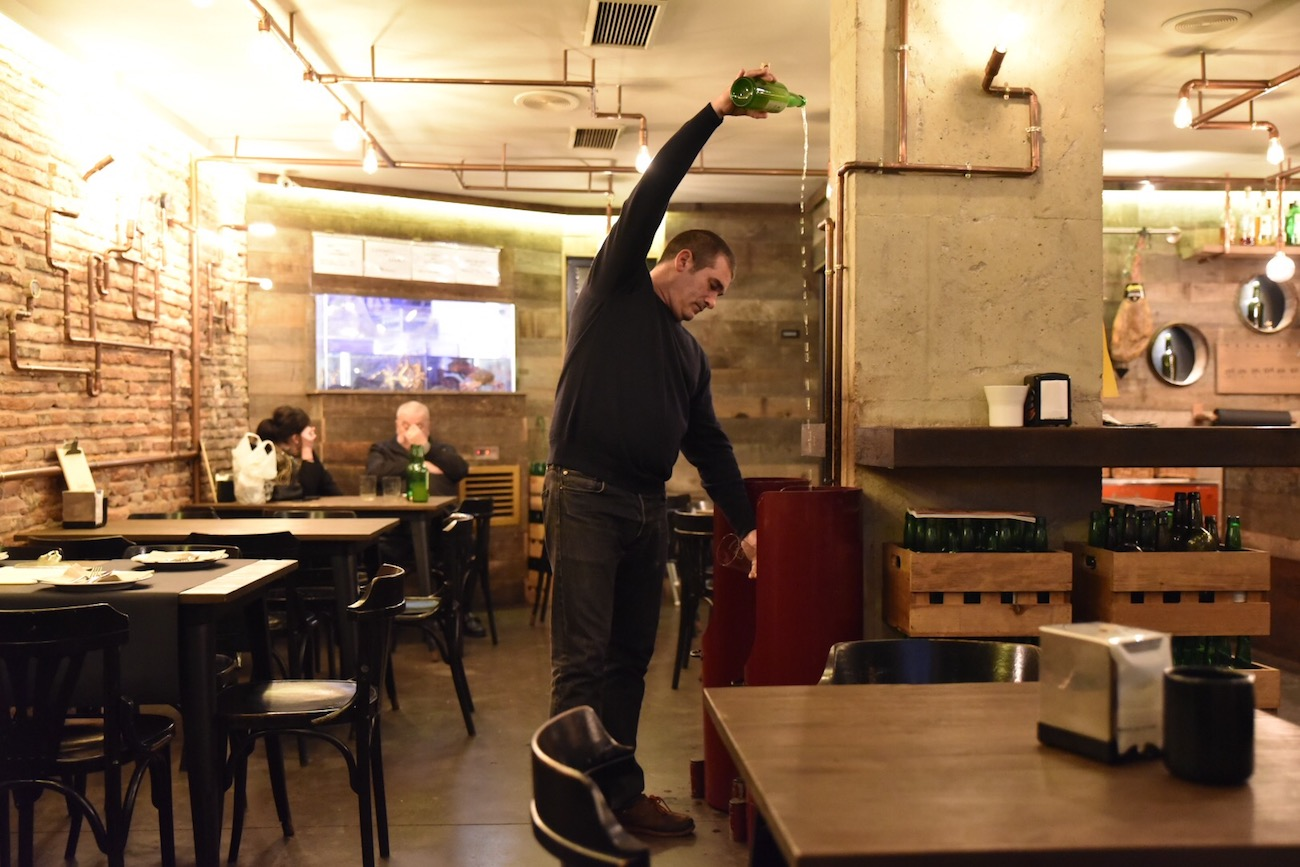 A long pour of Asturian cider