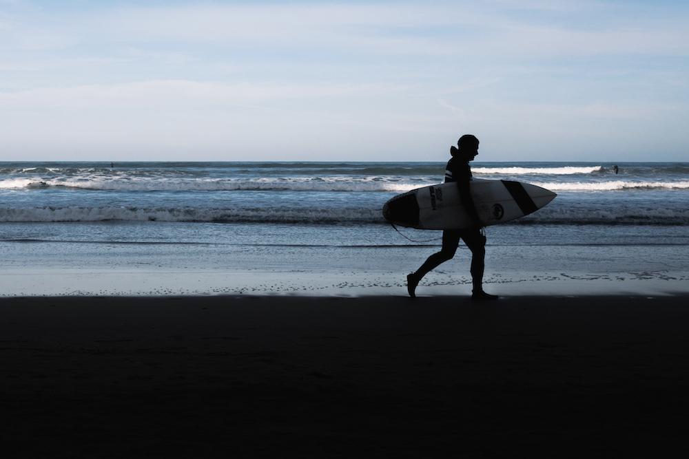 Surfers at Gijon's glorious Playa de San Lorenzo.