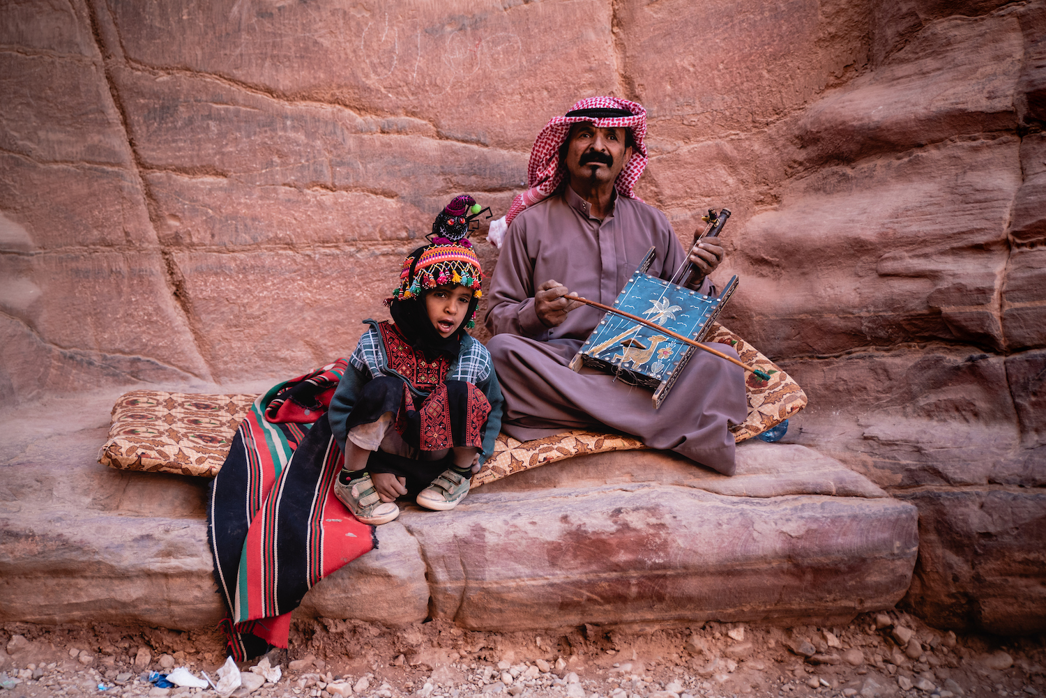 Father and son busking in the cavernous corridors of Petra. Halloween. By Ben Holbrook from DriftwoodJournals.com