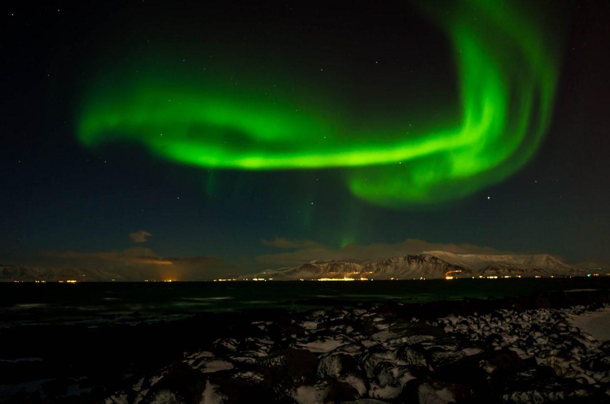 Northern Lights over Reykjavik. Photo by Serge via Flickr CC