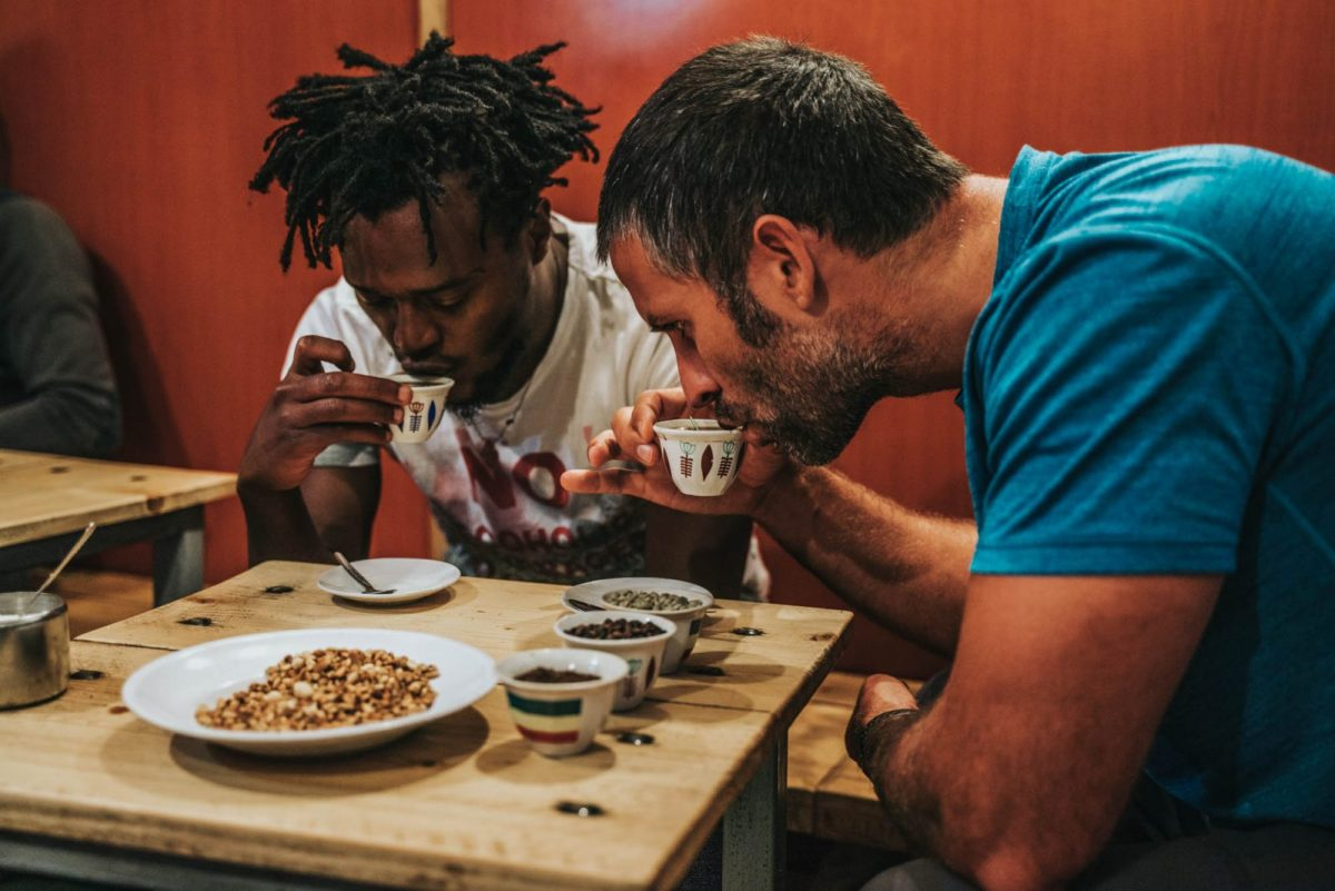 Our Go Addis Tours guide teaching Max the art of drinking coffee in Addis Ababa