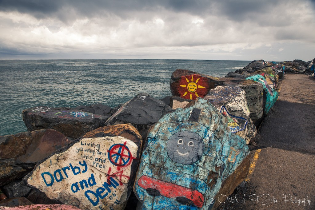 Painted rocks at the breakwall in Town Beach Park, Port Macquarie