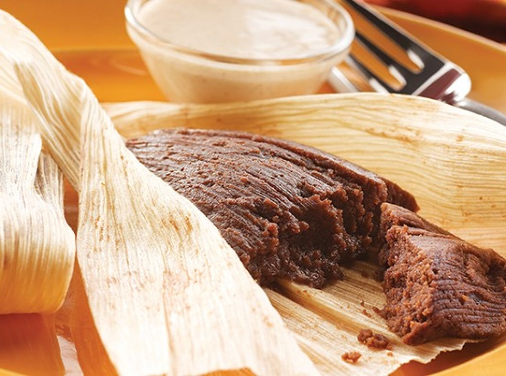 Tamal con chocolate. Colombian food.
