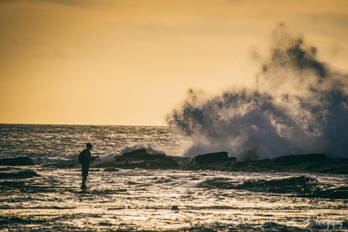 Local man fishing on Playa Pelada. Nosara. Costa Rica