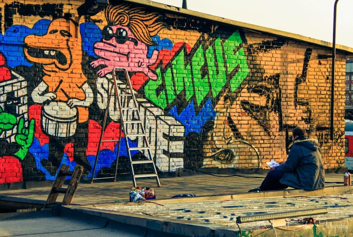 An artist in front his street painting. Kreuzburg, Berlin. Germany