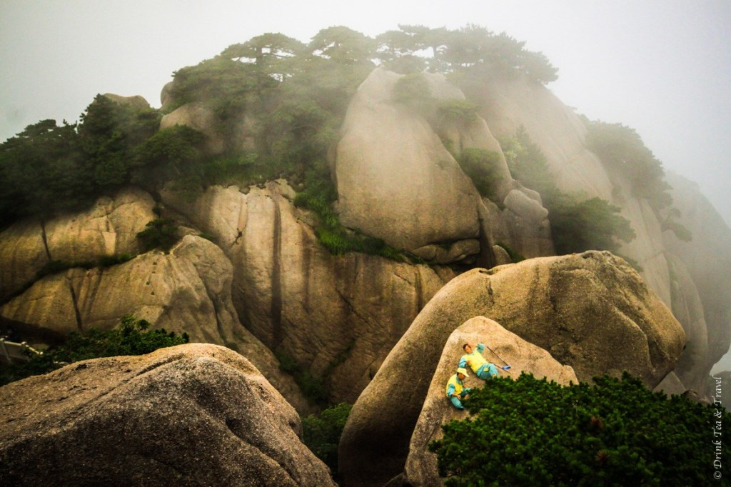 Maintenance workers hanging out on top of the rocks at Huangshan