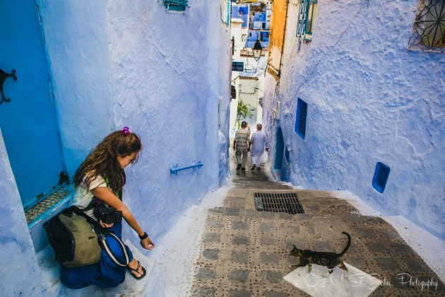 Oksana feeding cat in Chefchaouen. Morocco