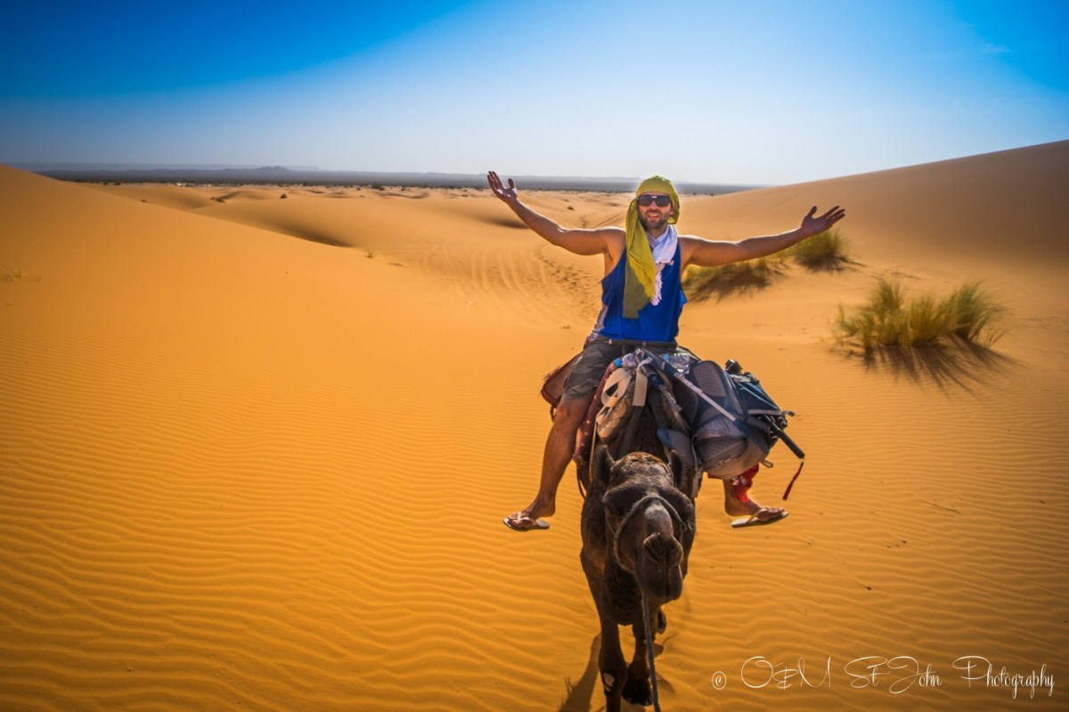 Max loving life on the camel. Erg Chebbi. Sahara Desert. Morocco