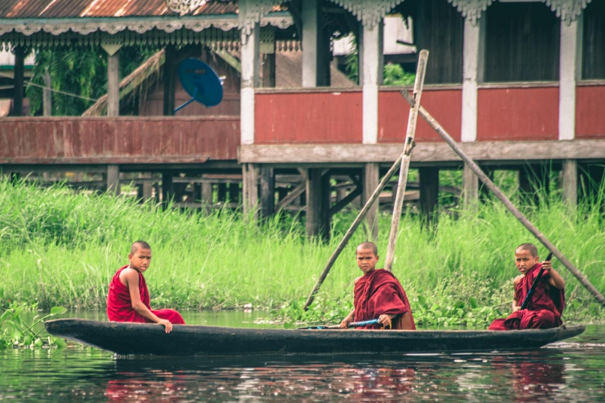 Myanmar travel: Young Burmese monks making their way across Inle Lake, Myanmar