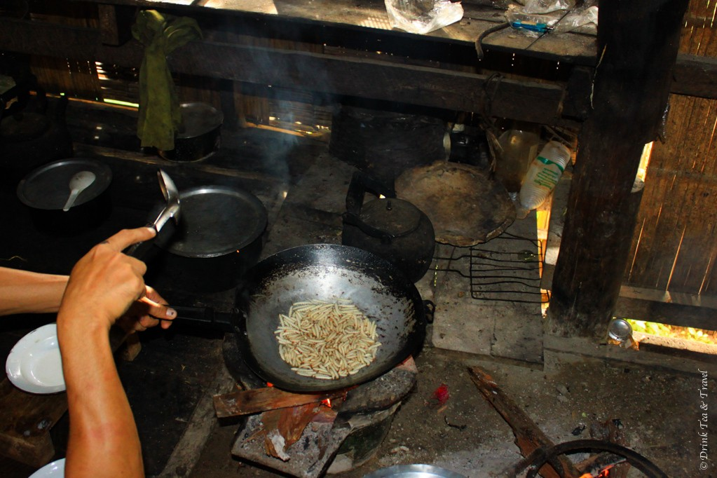 Bamboo worms being fried in oil