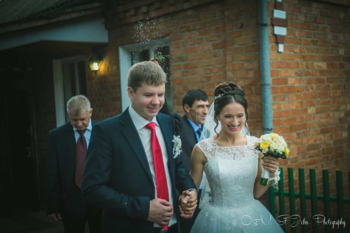 My cousin (groom) leaving the house with his bride. Ukraine Wedding Tradition