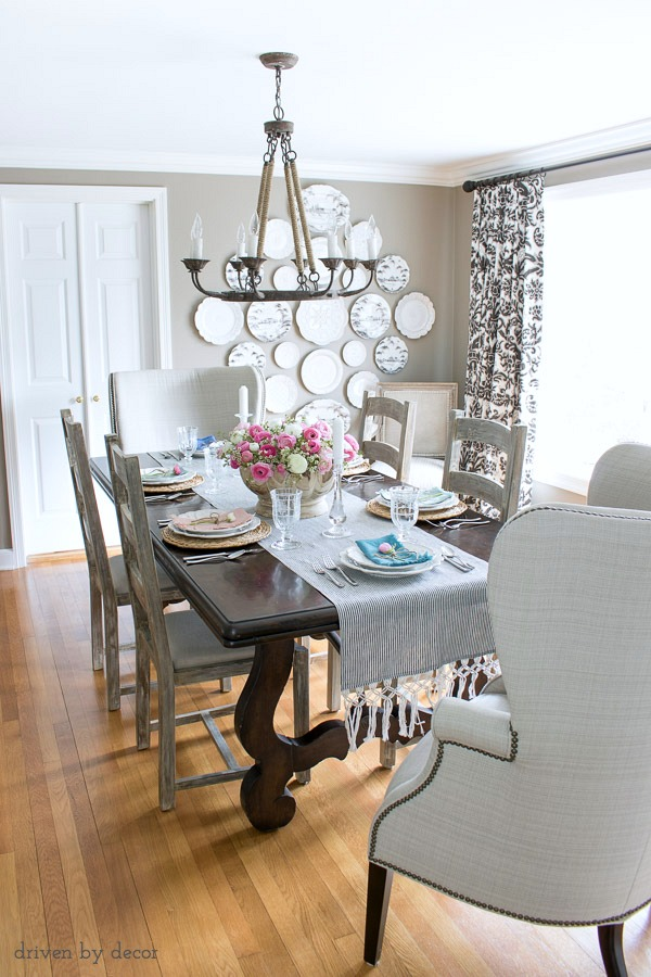 Dining Room In Neutrals With Ladderback Side Chairs Upholstered Wingback End Rope Chandelier