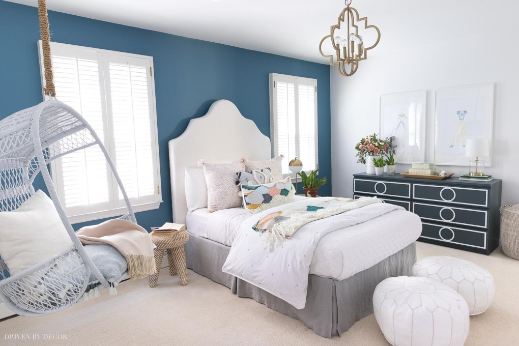 Love the blue accent wall (Behr Marquee's Blueprint paint color) in this boho chic bedroom!