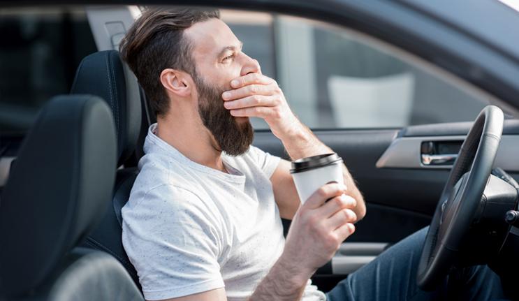 Sleepy Driver Drinking Coffee