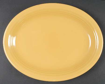 12 inch oval platter, yellow. Production Dates: July, 1938 - July, 1969.