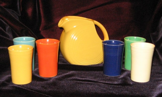 The Fiestaware promotional juice set of 1939. Yellow pitcher and six tumblers in the original colors.