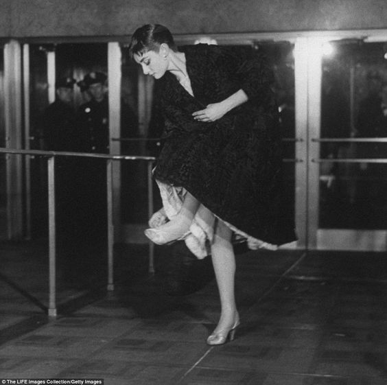 Audrey Hepburn enters the Center Theatre.