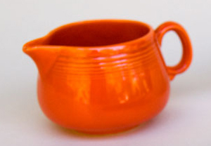 Promotional creamer in red.