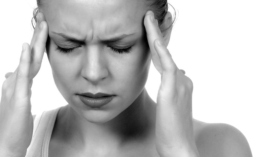 Picture of someone having a headache
