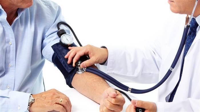 mens health risks blood pressure cuff doctor