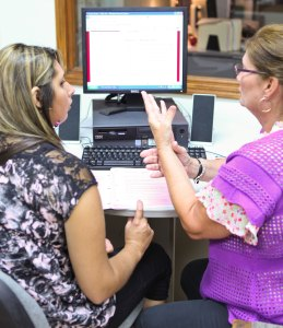DRTC Employment Training Specialist Vivian (pictured, right) helps an individual through the job search process