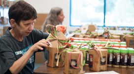 An individual assembles a Prairie Spice Gift Set.