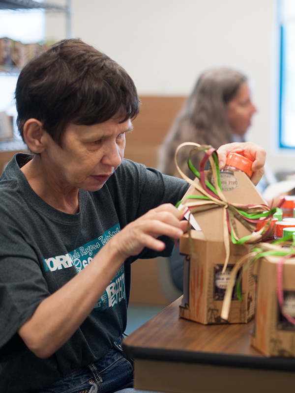 Angie packaging a Prairie Spices Gift Set.