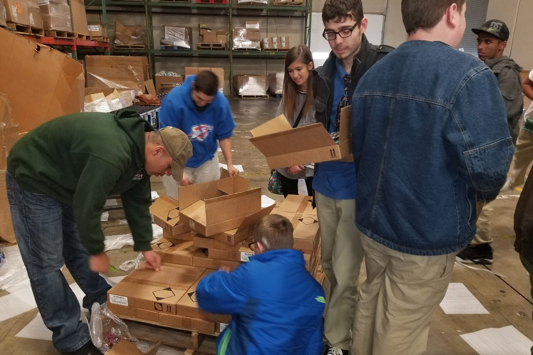 A group of students working together at a volunteer site.