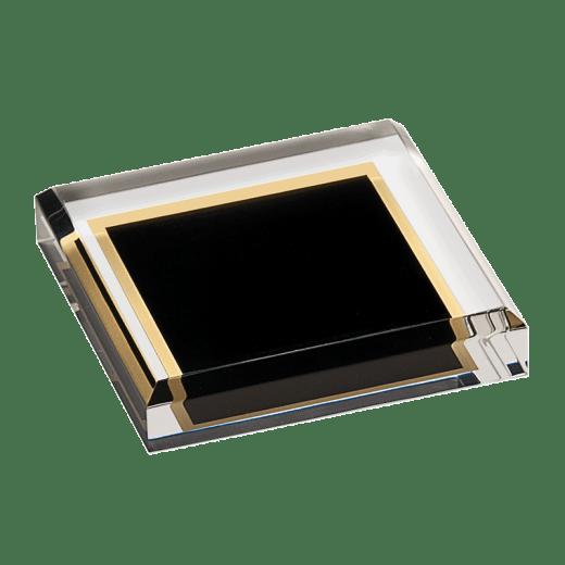 Flat black marbleized acrylic paperweight.