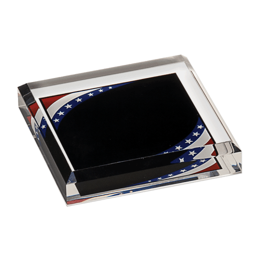 Stars and stripes design of marbleized acrylic paperweight.