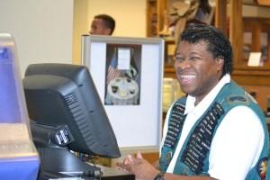 Derek smiling at the cash register at Tinker Air Force Base Vanwey Dining Hall.