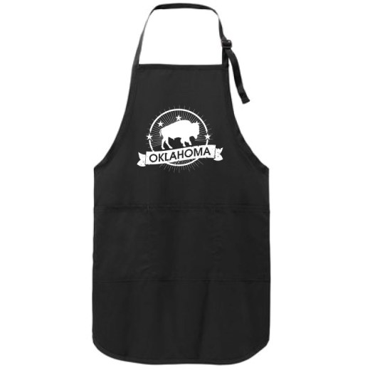 """Black apron with a white imprint of a buffalo in the middle of a circle with five stars forming an arch slightly above the buffalo. Banner below reads """"Oklahoma."""""""