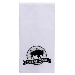 "Folded white tea towel with an imprint at the bottom showing a buffalo in the middle of a circle with five stars forming an arch slightly above the buffalo. Banner below reads ""Oklahoma."""