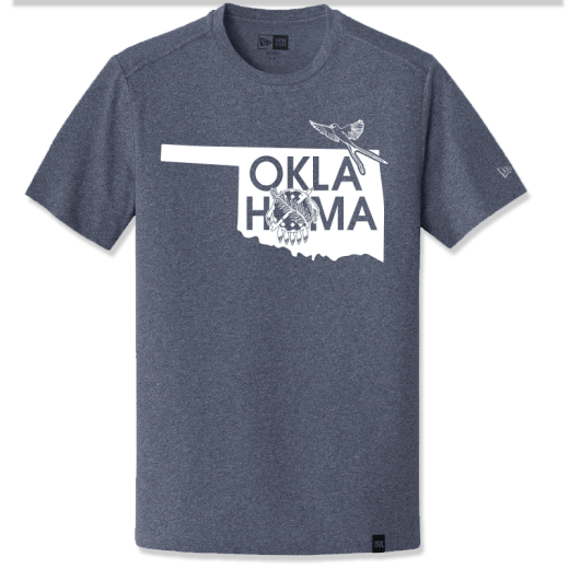"True Heather Navy t-shirt with the shape of Oklahoma design on chest. Graphic design also says ""Oklahoma"" where the second ""o"" is the state shield. Also features a scissor tailed flycatcher. New Era logo is visible on the left sleeve; New Era tag is on the bottom front of shirt."