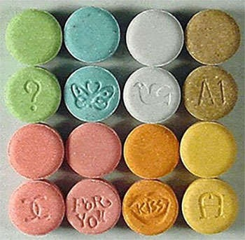 MDMA tablets in various colors.