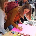People in Vancouver writing signs for the National Day of Action 2019
