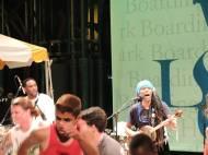 Hakmoun sings behind dancing audience members