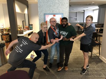 ATL team onsite together doing a power pose.