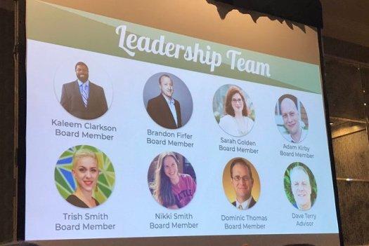 Slide showing faces of the 8 Atlanta Camp Leaders - ATL Board Members - Kaleem Clarkson, Brandon Firfer, Sarah Golden, Adam Kirby, Trish Smith, Nikki Smith, Dominic Thomas, and Advisor Dave Terry